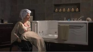 woman in wheelchair and ADL tub