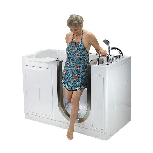 woman exiting petite walk in bathtub