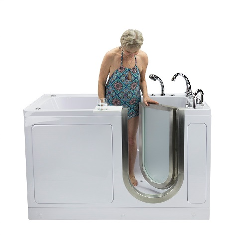 woman exiting ultimate walk in bathtub